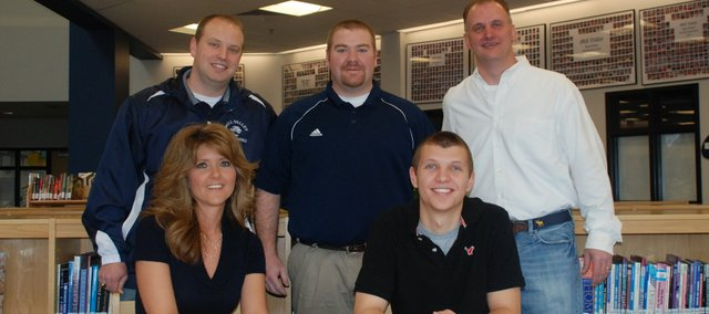 Max Carroll, Mill Valley senior, recently signed his letter of intent to throw the javelin for the University of Arkansas. Pictured at the signing ceremony are, from left, seated: Leslie Carroll and Max Carroll; and, standing: MVHS coach Chris Dunback, MVHS coach Cory Wurtz and Barney Carroll.