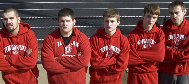 Tonganoxie High seniors Austin Stone, Reece Hollingsworth, Ben Field, David Powell and Tommy Heskett hope to lead the boys track and field team to a successful 2009 season.