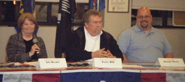 Basehor mayoral candidates Iris Dysart (far left) and Terry Hill, and City Council candidate Dennis Mertz respond to an audience question at the Meet the Candidates forum Tuesday night. Candidates for city council and school board met at the Basehor VFW Hall to speak to the community about their campaigns.