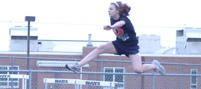 Ashley Gorman leaps over a hurdle during practice Monday at De Soto. The Wildcats open their track season on April 3 at Baldwin.