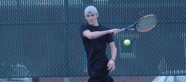 Brendon Hudson returns a serve from doubles partner Trevor Elmer. Hudson and Elmer will be De Soto's No. 1 doubles team when the team takes the court in it season opener Tuesday at Washburn Rural.