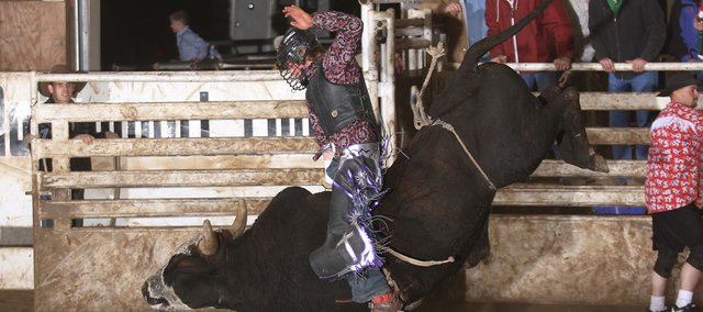 Caleb Hines rides a bull in December at a competition sponsored by the Kansas Junior Bull Riders Association in Fort Scott. Hines hopes to someday be a professional bull rider.  