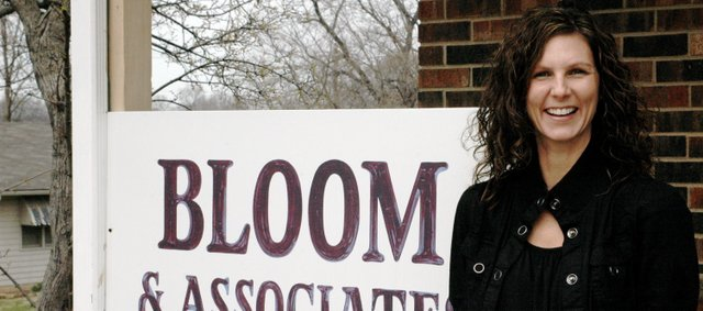 Lisa Foltz, a physical therapist assistant at Bloom and Associates Therapy, stands in front of the Bloom and Associates office at 924 Locust St.