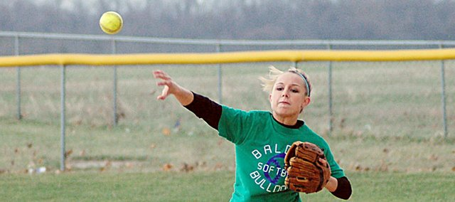 Baldwin High School senior Haley Finucane throws a ball from second base to first base during a drill Tuesday afternoon at practice. The Bulldogs open their season by hosting Wellsville for a game at 4:30 p.m. Tuesday.