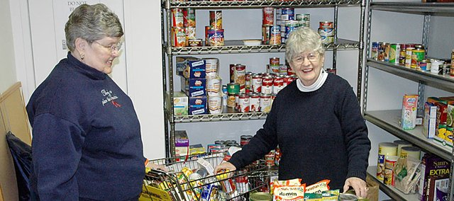 Ruth Dickinson, left, and Delma Hitchcock look over the bountiful supply of food that&#39;s currently in the First United Methodist Church&#39;s Community Food Pantry. The pair help out with the project that provides food to those in need.