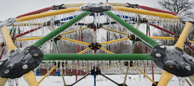 Some playground equipment in Chieftain Park is covered in a thin sheet of ice during a winter storm in December of 2007.