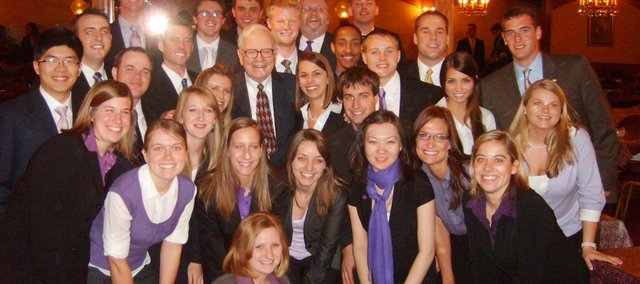 Students from Kansas State University's Student Finance Association crowd around famed financier Warren Buffett. The group, led by president Laura Liston of Shawnee, got to meet Buffett in a two-hour question-and-answer session Friday in Omaha, Neb.