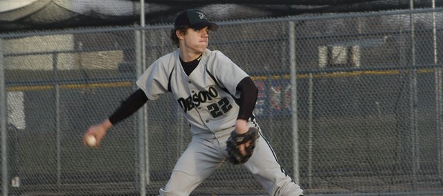 De Soto senior Tommy Elmer delivers a pitch last season. Elmer and the Wildcats will play their first game of the season in a doubleheader against Baldwin Thursday at home.