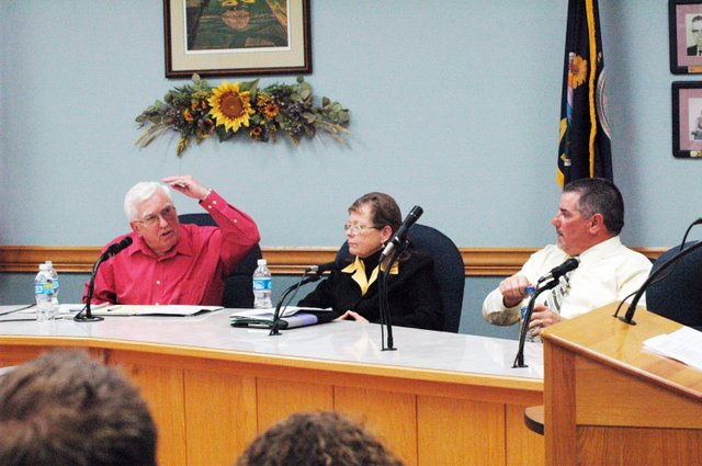 Mayor Tom Pyle gestures as Jean Farmer and Scott Hopson look on during Thursday's mayoral candidate forum at Eudora City Hall.
