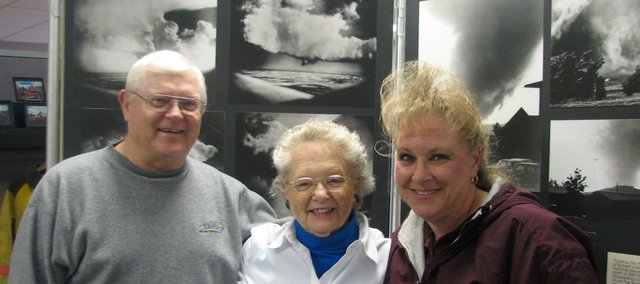 Basehor Historical Society chairman Ken Massingill (left), historical society fundraiser Lela Wiley(middle)  and historical society director Carla Crawford stand with the Kansas Tornados exhibit at the Basehor Historical Museum. Crawford said the exhibit would give visitors a greater insight into the history of Kansas storms.