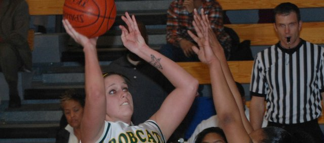 Whether facing one defender or two, as was the case against Sumner Academy, Basehor-Linwood sophomore Megan Bergstrom was a force to be reckoned with on the basketball court this season. For her efforts, she was named to the All-Kaw Valley League first team along with teammate Bren Koontz.