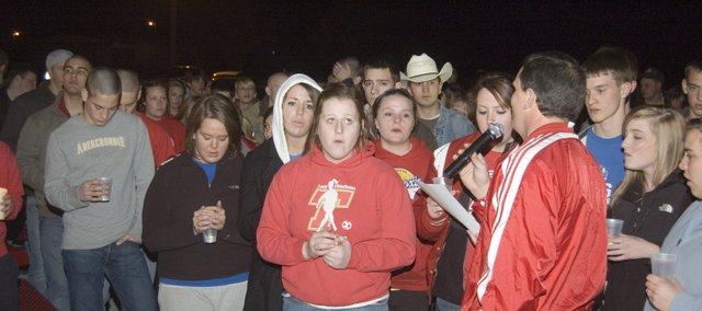 Students join THS principal Jamie Carlisle in song at Wednesday's candlelight vigil at the Chieftain Remembrance Walk in front of Tonganoxie High School. The vigil was a way for students and other community members to join together in prayer for high school students Austin Stone, Connor Olson and Jake Ostermeyer. Stone is in the intensive care unit at University of Kansas Hospital after a complication at the dentist's office as he was awaiting having his wisdom teeth taken out. Olson has bone cancer and starts chemotherapy Friday and Ostermeyer will undergo a kidney transplant in June.