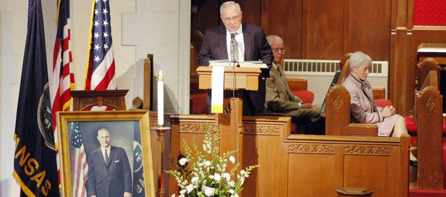 Baker University President Emeritus Dan Lambert speaks to the crowd gathered for a memorial service for former U.S. Senator James B. Pearson. Behind him are David Seaton, Pearson's press secretary, and former Sen. Nancy Kassebaum Baker, who succeeded Pearson in 1978. There were more than 150 people at the service in Baldwin City's First United Methodist Church.