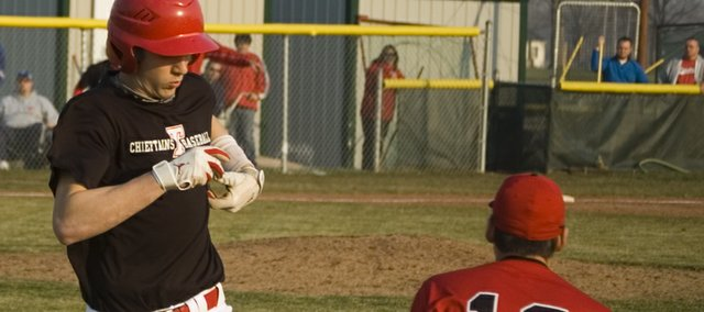 Ethan Lorance beats out a throw for an infield single in the fifth inning of Tonganoxie High's 8-7, comeback victory over Jeff West on Tuesday. The Chieftains won the second game, 15-3, for a sweep.