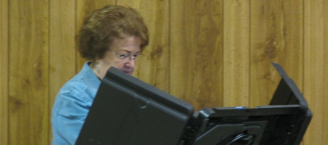 Veronica Stallbaumer casts her vote for the Basehor city and school board elections at the Holy Angels Catholic Church. Terry Hill won the mayors race, and Richard Zamora won the race for Position 5 on the school board. 