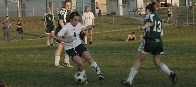 Danielle Price weaves through traffic against Basehor-Linwood Wednesday at De Soto. Price scored five goals in De Soto's 8-0 win.