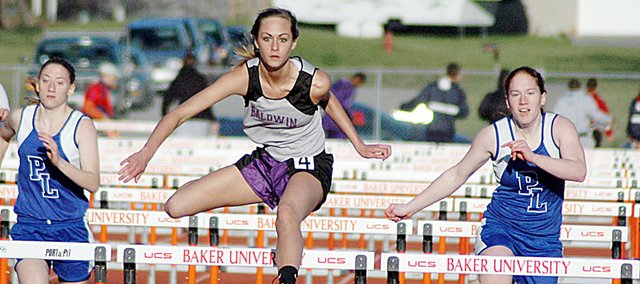 Baldwin High School sophomore Lyndsey Lober, center, won the 100-meter hurdles Friday. The BHS girls' team won the Baldwin Invitational with 152 points.