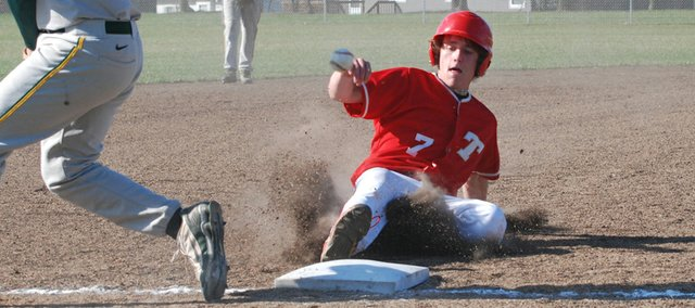 Jace Waters slides safely into third base during Tonganoxie High's 12-0 victory at Basehor-Linwood on April 8.