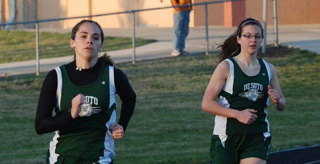 Jordan Kline and Renee Reichard run Thursday at the Mill Valley track meet. De Soto sent a split-squad to the Mill Valley meet and top varsity athletes to the K.T. Woodman meet Friday in Wichita.