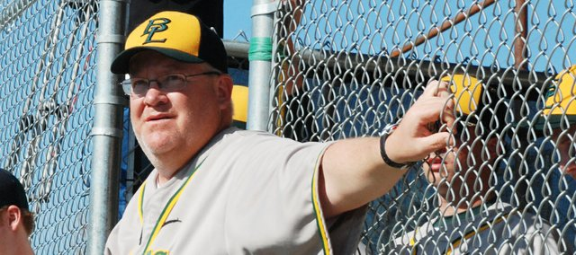 Basehor-Linwood baseball coach Dave Svoboda watches as starting lineups are announced prior to the Bobcats' first game ever at the newly built Eberth Field on the BLHS campus.