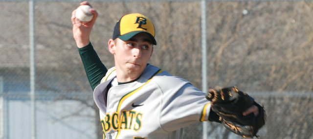 Basehor-Linwood senior Justin Gripka fires a pitch during the first inning of the Bobcats' inaugural game at Eberth Field. Tonganoxie defeated BLHS, 12-0.
