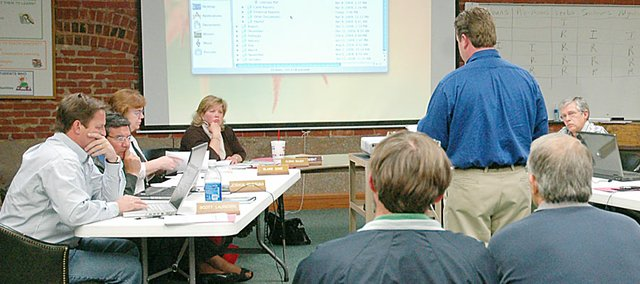 Gabe Manning, standing, of Manning Construction, recommended the Baldwin Board of Education accept the low bids for the Baldwin Junior High School renovations and athletic complexes at Monday's meeting.
