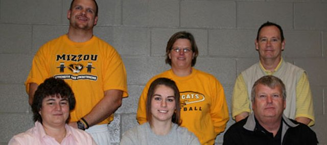 Basehor-Linwood senior Tiffany Jennings recently signed a letter of intent to continue her softball career at Kansas City Kansas Community College. Pictured at the signing ceremony are, from left, front row: Kathy Jennings, mother; Tiffany Jennings; Pete Jennings, father; and, back row: BLHS strength coach Ross Schwisow; BLHS softball coach Susan Mayberry and assistant coach Jeff Venema.
