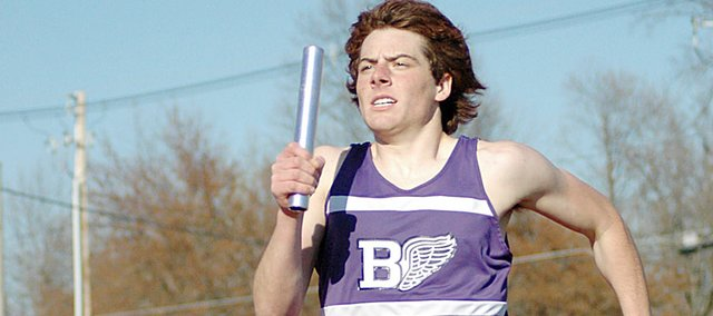 Baldwin High School sophomore Tony Weiss runs his leg of the winning 3,200-meter relay Tuesday at the Baker Relays.