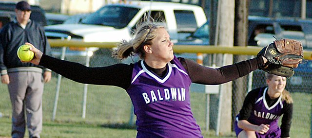 Baldwin High School senior Alex Zordel winds up before throwing a pitch during the Bulldogs' first game Wednesday versus Spring Hill. BHS won the first game 6-1 and the second contest 5-4.