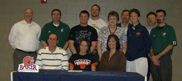 Bren Koontz, Basehor-Linwood senior, originally planned to give up basketball when she headed to college. After a strong finish to the season, however, she changed her mind and signed a letter of intent to play at Baker University in Baldwin. Pictured at the signing ceremony are, front row (from left): Mark Koontz, Bren Koontz and Karen Koontz; second row: club coach Pat Jeannin, BLHS assistant Bruce Courtney, Eric Koontz, Jean Cain, Baker coach Susan Decker and BLHS coach Noah Simpson; and, back row: BLHS strength coach Ross Schwisow, summer coach Bob Schmidt and BLHS athletics director Joe Keeler.