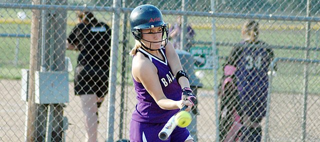 Baldwin High School senior Ariel Sanders swings through a pitch Tuesday afternoon. Sanders' double scored two runs as BHS beat Louisburg 6-0 and 6-1.