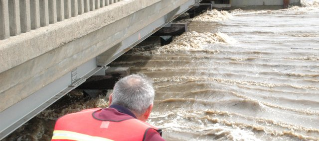 Bill Green, former Leavenworth County Public Works director, watches Stranger Creek floodwaters rush under a bridge on County Road 5 in this 2007 photo. Flooding on Stranger Creek caused the county to close several roads,