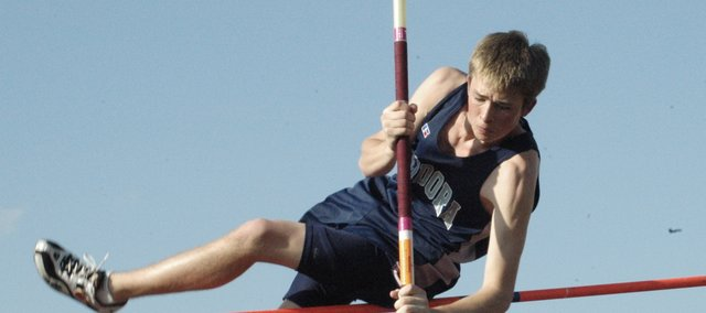 Jacob Beck clears the bar in the pole vault at the Cardinal Relays Friday in Eudora. Beck cleared 9-feet, 6 inches in the event. Eudora broke three school records at the meet.