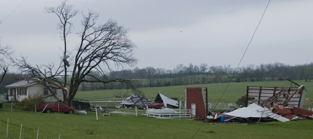 Barns, cars and several outbuildings were razed by a tornado that touched down along Leavenworth County Rd. 25 near I-70 Saturday, April 25, 2009. This was part of the same storm that past over Lawrence before moving northeast.