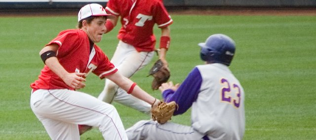 Tonganoxie High shortstop Jace Waters tags out Spring Hill's Colton Ghumm as he attempts to steal second base. The Chieftains were knocked to the consolation bracket by the Broncos for the second straight year at the Butch Foster Memorial Baseball Classic with Spring Hill's 8-1 win Friday afternoon.