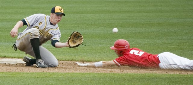 Ethan Lorance slides safely into second base for a steal in the second inning of Tonganoxie High's 13-6 Saturday afternoon win against Basehor-Linwood at CommunityAmerica Ballpark in Kansas City, Kan.