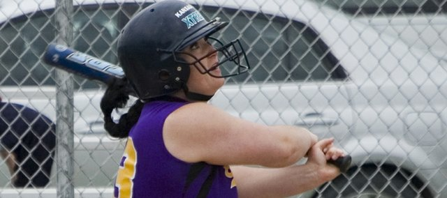 Lezley Lawson watches a ball fly off her bat on Monday during McLouth High's doubleheader at Silver Lake. The Bulldogs suffered their first loss of the season in the opener but responded with a 10-4 victory to split with the Eagles.