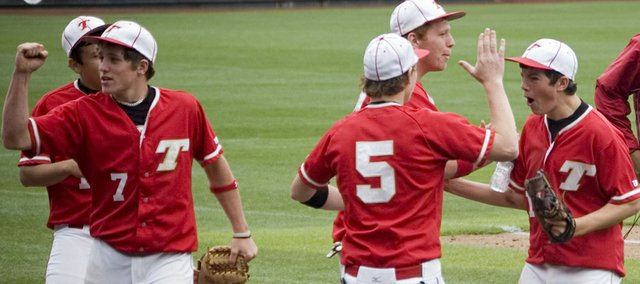 The Tonganoxie High baseball team was fired up after losing its first game in the Butch Foster Memorial Baseball Classic on Friday and responded with two big victories this past weekend at CommunityAmerica Ballpark in Kansas City, Kan. After ending an inning with a double play on Friday, Jace Waters gives a fist pump as Jon Harris high-fives Dylan Puhr.