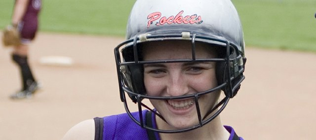 Kendall Patterson, senior catcher for McLouth High, homered to left at Holton on Tuesday to become the all-time career hits leader in Kansas high school softball history.