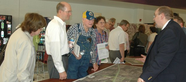 Brett Wood, right, lead road designer with GBA Architects Engineers, discusses the Kansas Highway 7 and Interstate 70 interchange project with Basehor City Administrator Carl Slaugh, at middle, and Bonner Springs residents Glen and Billie Craycraft, at far right.