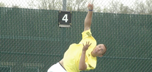 Andrew Konetzni fires a serve Saturday at the De Soto Invitational. Konetzni beat teammate Matt Edwards for the singles championship. De Soto's top two singles players could meet again Thursday at regionals.