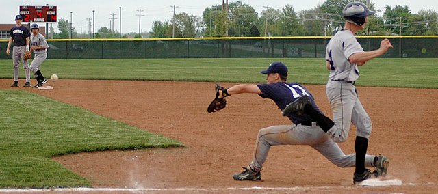 Baldwin High School junior Braden Phillips, right, beats the throw to first base to record a single during the fourth inning of the first game Tuesday. BHS scored three runs in the inning, but lost the game 8-7 to Eudora.