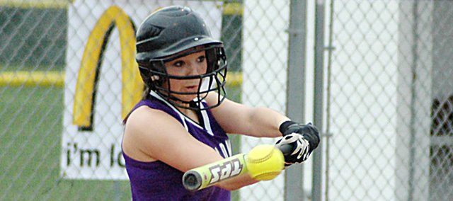 Baldwin High School freshman Kaysha Green swings her bat through the ball as she hits a single Tuesday afternoon at Eudora. Green helped the Bulldogs split a doubleheader with the Cardinals. BHS lost 7-4 before winning the second game 12-7.