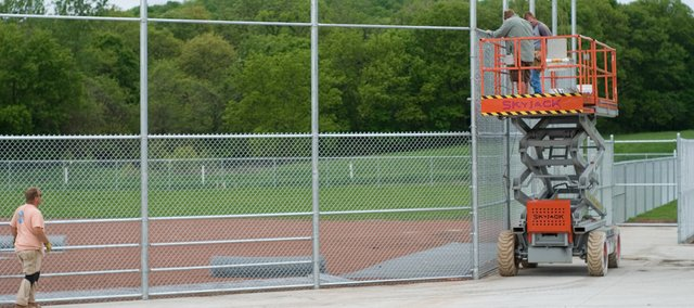 Workers from US Fence install the chain-link fence around one of the new Tonganoxie Recreation Commission ball fields just north of the current ball fields at the Leavenworth County Fairgrounds.
