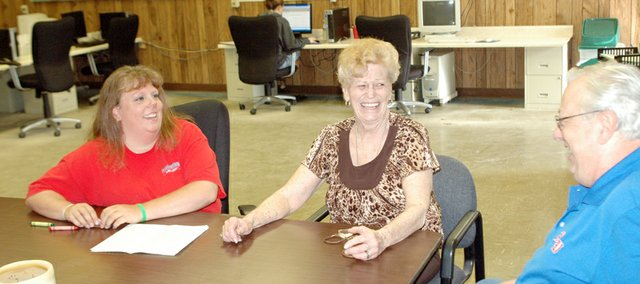 Eudora Community Learning Center coordinator Angie Miller talks Thursday with Sherry and Norm Lawrence at the CLC. Sherry Lawrence, who is in her sixties but declined to give her exact age, will get her high school diploma during the CLC's graduation ceremony Friday.