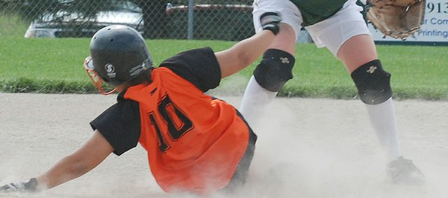 Bonner Springs senior Starian Porchia slides safely into second base before Basehor-Linwood's Megan Rehm can receive a throw for an attempted force out.
