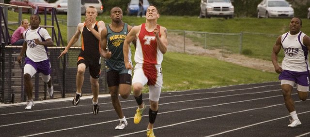 DJ Lindsay breaks away from the pack on his way to a first-place finish in the boys 200-meter dash finals on Wednesday at the Kaw Valley League Meet in Kansas City, Kan. A Tonganoxie High junior, Lindsay won three league titles with victories in the 400-meter dash and as a member of the THS 4x400 relay team.