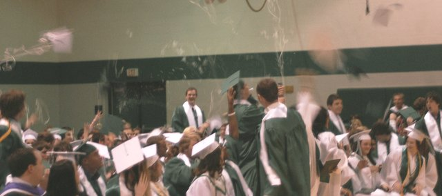 The De Soto High School Class of 2009 members celebrate Principal Dave Morford's announcement they are now graduates.
