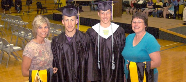 Two McLouth High School seniors and their mothers are graduating  the sons from MHS and the mothers from Emporia State University with masters degrees. From left, Janna Terry and son, Skyler Terry, and Jarrod Bechard and mother, Vicki Bechard.