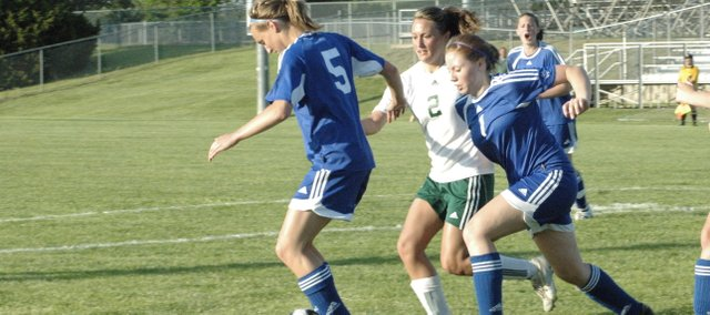 De Soto senior Brooke Lewis fights for the ball against K.C. Christian last Thursday in De Soto. The Wildcats won, 5-0.